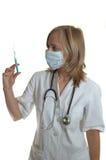 Doutor da mulher nova com seringa fotografia de stock