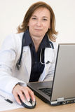 Doutor e computador imagem de stock