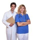 Doutor e enfermeira de riso fotos de stock royalty free