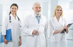 Doutor e equipe Imagem de Stock Royalty Free
