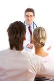 Doutor e pares novos Fotos de Stock