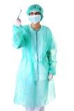 Doutor fêmea com um escalpelo Fotos de Stock Royalty Free