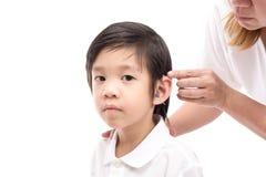 Doutor Inserting Hearing Aid fotografia de stock royalty free