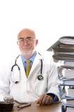 Doutor na mesa Imagens de Stock Royalty Free