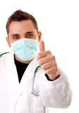 Doutor novo com polegares acima no fundo branco Fotos de Stock