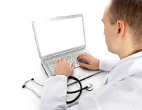 Doutor novo com portátil fotografia de stock royalty free