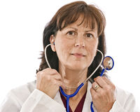Doutor Putting On Stethoscope Fotografia de Stock