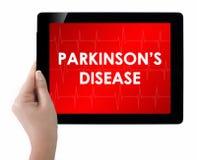 Doutor que mostra a tabuleta com texto da DOENÇA de PARKINSONS Imagens de Stock Royalty Free