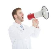 Doutor Screaming Into Megaphone Imagem de Stock Royalty Free