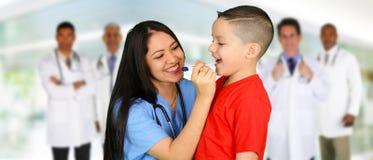 Doutores e enfermeira Foto de Stock Royalty Free