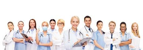 Doutores e enfermeiras fêmeas de sorriso com estetoscópio Fotografia de Stock
