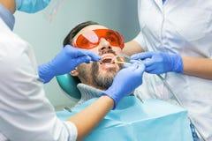 Doutores e paciente dentais imagens de stock royalty free