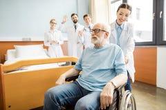 Doutores e paciente superior Imagens de Stock