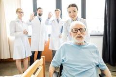 Doutores e paciente superior Imagem de Stock Royalty Free