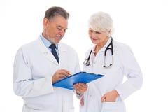Doutores masculinos e fêmeas fotos de stock royalty free