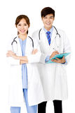 doutores masculinos e fêmeas que estão junto Imagens de Stock Royalty Free