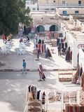 Douz in Tunisia square with shops of traditional items. Rugs and other Arab objects Stock Images