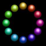 Douze boules colorées Photos stock
