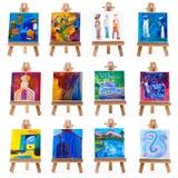 Douze mini peintures sur des supports d'isolement sur le blanc Images stock
