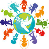 A dove, children and the world. Cute children silhouettes around the World with pigeon. Symbol of peace. Earth Planet with colored children silhouettes Royalty Free Stock Photography