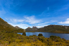 Dove Lake across buttongrass moorland with Cradle Mountain in ba. View of Dove Lake across buttongrass moorland with Cradle Mountain in background at Lake St stock image
