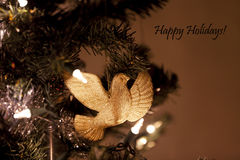 Dove ornament with Happy Holidays sign Royalty Free Stock Images