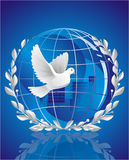 Dove of peace. Near globe Royalty Free Stock Image