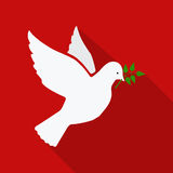 Dove of peace flying with a green twig olive Stock Photo
