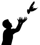 Dove release. Editable vector silhouette of a man releasing a dove Royalty Free Stock Images