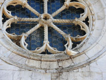 Dove resting on  old rose window of romanesque church valdicaste Royalty Free Stock Image