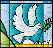 Dove stained glass. Dove in stained glass with olive branch Stock Photo