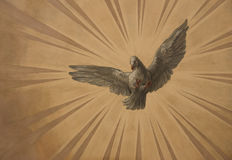 Dove in the sun. Dove on the sun rays background on the capital of St. Charles church - Vienna. Painting royalty free stock image