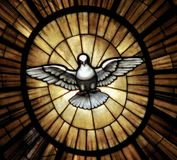 A Dove Symbol of Piece from the Main Altar in the Vatican. The front of the Vatican altar has a stained glass window of a dove which promotes the Holy Spirit and Royalty Free Stock Photos