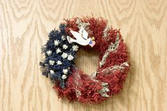 Dove Wreath. A red, white, and blue christmas wreath with a dove and heart flag Stock Photography