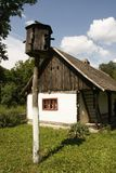 Dovecot, pigeonry and rustic village house with white walls and wooden roof. stock photo