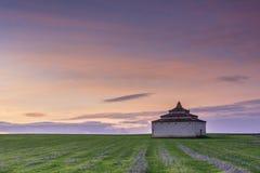 Dovecote built in stone at dusk. In Tierra de Campos, Castilla Spain Royalty Free Stock Photo