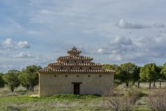 Dovecote built in stone at dusk. In Tierra de Campos, Zamora Castilla y Leon Spain Stock Photo