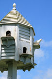 Dovecote with dove. White dovecote, with dove, against blue sky Stock Photos