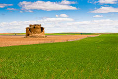 Dovecote, field and sky. Dovecote and arable Agricultural in central Spain Royalty Free Stock Photos