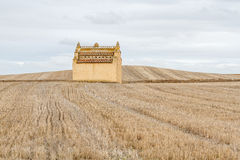 Dovecote and harvested cereal fields. Stock Photography