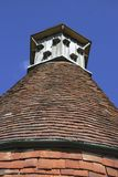 Dovecote on tiled roof of English house Royalty Free Stock Photos