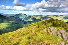 Lone hiker on Hartssop above How. The Dovedale and Patterdale valleys Royalty Free Stock Photography