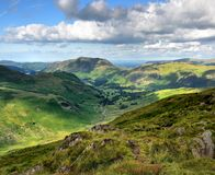 Sunlight on the Patterdale and Harstop valleys. The Dovedale Valley from Hartsop above How Royalty Free Stock Photo