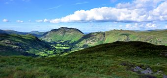 Sunlight on the Patterdale Common. The Dovedale Valley to Place Fell Stock Images