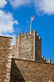 Dover Castle with waving Union Jack. United Kingdom flag on the Medieval Dover Castle in England Royalty Free Stock Photos
