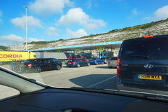 DOVER, KENT, ENGLAND, AUGUST 10 2016: Holidaymakers cars queuing at the check in for the cross channel ferry to France. DOVER, KENT, ENGLAND, AUGUST 10 2016 Royalty Free Stock Photo