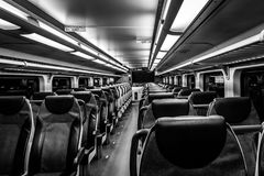 Dover, NJ USA - November 1, 2017:  NJ Transit train at night with empty seats, black and white Stock Photography