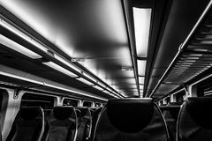Dover, NJ USA - November 1, 2017:  NJ Transit train at night with empty seats, black and white Stock Photo