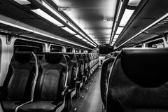 Dover, NJ USA - November 1, 2017:  NJ Transit train at night with empty seats, black and white Royalty Free Stock Photography