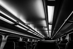Dover, NJ USA - November 1, 2017:  NJ Transit train at night with empty seats, black and white Stock Photo